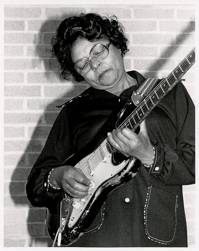 Gloria Jean Brown Manor Shredding a guitar like a boss