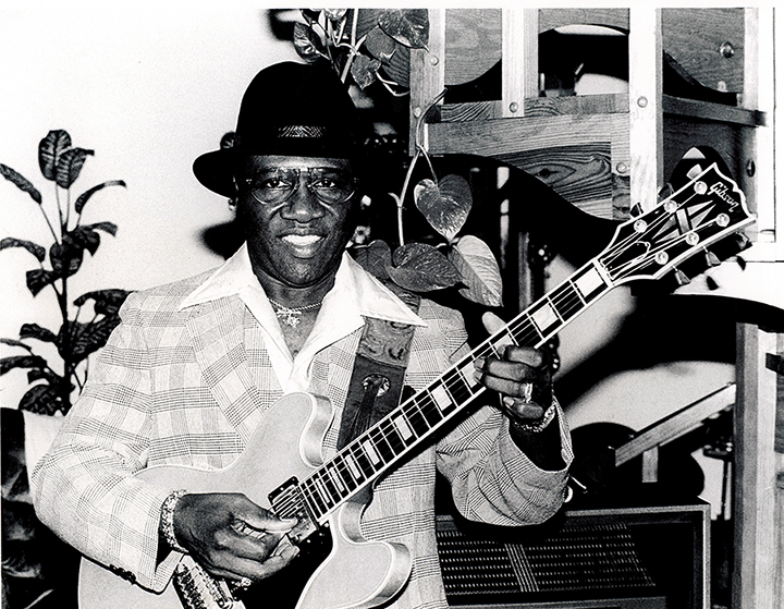 HEnry Hubbard with his guitar, photo by Clay Shorkey